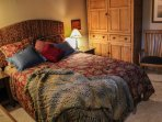 Upstairs bedroom with a queen bed.