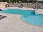 12 x 6m saline pool surrounded by a large, secure sun patio