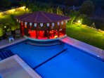 Night view of the pool and swip-up bar...