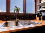 Enjoy the mountain vistas as you do the dishes.