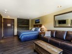 Utilize the queen-sized pullout bed in the living area for additional friends.