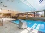 The pool extends from indoors to outdoors.
