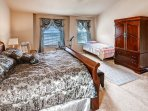 Get a good night's sleep in this plush master bedroom