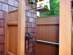 Outdoor shower with rainfall shower head