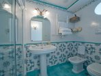 The bathrooms are all decorated with lucid maiolica tiles
