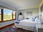 Suite #3: ground level bedroom with private lanai, queen bed and private bath.
