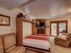 Queen Murphy bed with plush bedding, comfy mattress and snowy forest view
