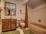 Full bath furnished with fluffy towels and Toiletries