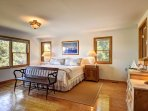 Master suite #2: spacious bedroom with king bed and private bath with free-standing soaking tub.
