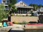 The house looking up from the 80 ft dock highlights a great semi enclosed swimming area and seating