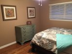 Queen bedroom with new mattress and linens
