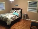 Queen bed in its large room.  Shades throughout the house so it can be as sunny or shady as you like