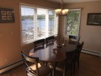Dining area overlooks the lake and seats 6-8.