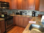 Two coffee machines, microwave, dishwasher, gas oven & range, triple filtered drinking water