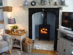 Cosy up to the crackling wood burner on quality furniture (2016)and watch a BluRay /DVD