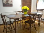 Dining room table with 1 leaf (it has 2).  Seats 4-8 comfortably.