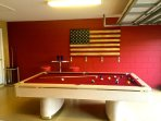 Stunning newly refurbished games room with pool table, ping pong, and seating.