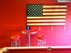 Seating in games room with unique home made USA flag artwork / coat hanger.