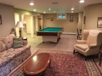 Pool table and tv and sitting area on the lower level
