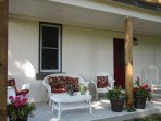 The covered veranda lets you enjoy nature without getting a sunburn or feeling the rain.