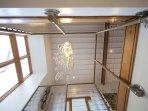 Drop chandelier; floor to ceiling window