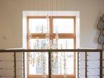 Chandelier / floor to ceiling window