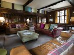 Oak Parlour Sitting Room - a comfortable space to unwind in front of the fire