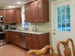 Kitchen is equipped with brand new granite counter tops, stainless steel appliances