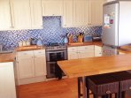Beautiful oak kitchen, fully equipped with dishwasher, oven, large fridge freezer & breakfast bar.