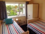 Bedroom 2 is a twin or bunk room great for the kids or the oldies. Quiet with garden views.
