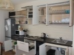 Kitchen.Equipped with a dishwasher and all necessary appliances. TV  and kitchenware.