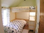 Bedroom 2 - full size single and a smaller loft bed (6yrs +).