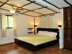 Oversized master bedroom with AC, king bed, TV, and ample closet space.