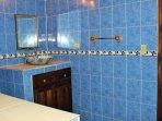 Calming full bathroom with separate vanity area