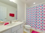 Upstairs full  bathroom  decorated for the young ones, hair dryers in all bathrooms
