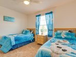 For the Boys blue  frozen bedroom with twin beds ,  Flat screen TV , and ceiling fan