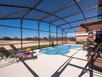 All building work is now finished  view from the pool ,wooden table,7 chairs,2relaxers, swing hamock
