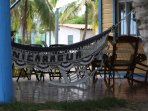 Ground level patio with 4 hammocks and eating area