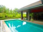 large pool lush garden