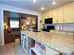 Large kitchen island. Kitchen is stocked with dishes and cookware with service for four plus.