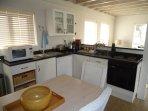 Kitchen with fridge/freezer, microwave, dishwasher coffee machine, electric hob/oven/appliances etc.