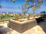 Backyard full 360 ocean view with BBQ and outdoor furniture.