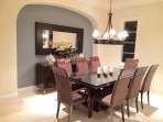 Formal dining room with marble floor.