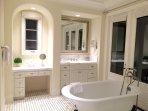 Master bathroom with classic tub and sauna.