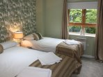 The beatifully-decorated second bedroom has a single and a double bed