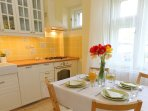Fully equipped kitchen with spring flowers