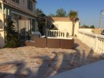 Large terrace with comfy sofas and beds