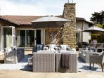 Large outdoor seating and dining areas with hot tub