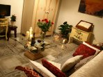 The pretty living area has satellite TV & sofa bed for 1 adult or 2 children