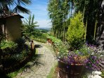 Beautiful garden surrounds the villa with stunning views over the hills and valley
